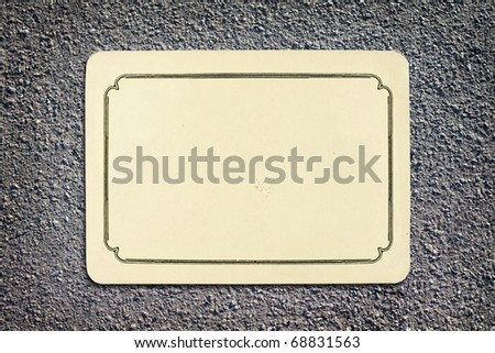 vintage blank card on asphalt texture background with copy space
