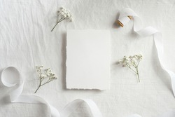 Vintage blank paper card mockup, greeting card design for wedding or birthday. Top view with copy space. Romantic minimal style.