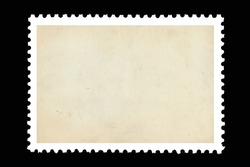Vintage blank postage stamp on a black background