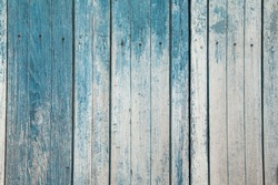 Vintage blue and white vertical wooden boards. Front view with copy space. Background for design. Old painted wood abstract background.