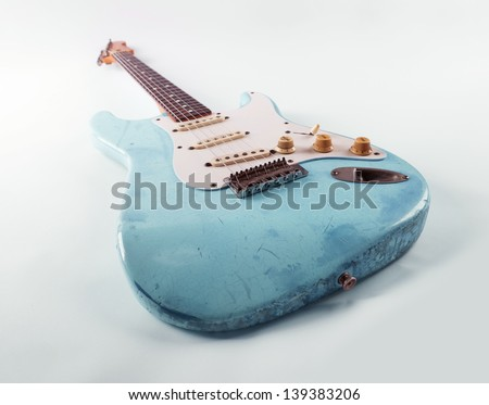 vintage blue guitar with worn...