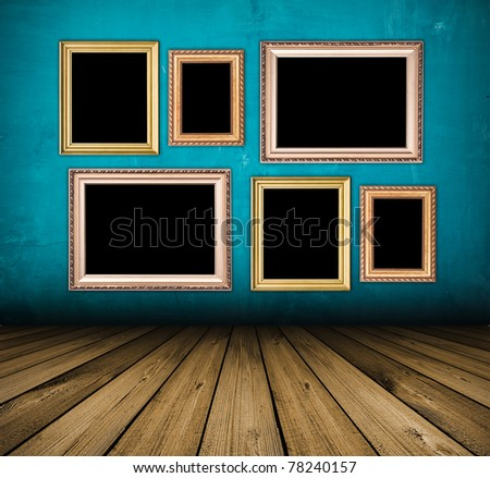 vintage blue interior with empty frames hanging on the wall