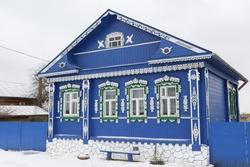 Vintage blue traditional national rural wooden house with ornamental carved windows, frames in Kideksha village, Suzdal district, Vladimir region, Russia. Russian folk style in architecture. Landmark