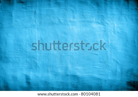 vintage blue wall as background with artistic shadows added
