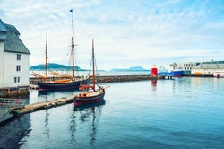 Vintage boats in the port of Alesund, Norway. Summer landscape. Famous travel destination