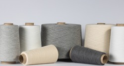 Vintage bobbins with cotton thread close up on white isolated background. Concept for textiles, and thread industry