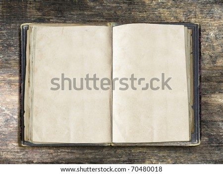 Vintage book, open, on old wooden table, with clipping path - stock photo