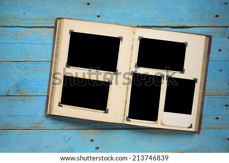 vintage book with empty photo frames photo corners