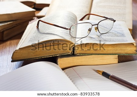 Vintage books and glasses on wooden table