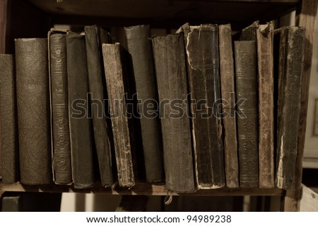 Vintage books in a row. - stock photo