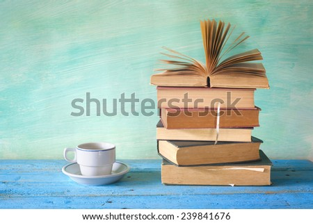 vintage books with a coffee cup, studying, learning, literature concept, copy space