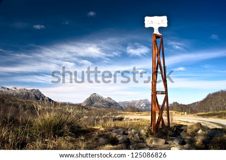Vintage border post, Road sign at the Patagonia border of Argentina and Chile in Paso Cardenal Samore. Chile