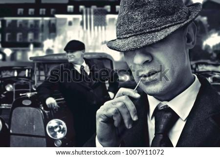 ab8132f0438 vintage bossy Italian mafia gangsters in 1930 s near classic car