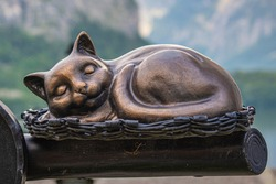 Vintage Bronze Resting Cat. Metal Figure of Cat sleeping in the basket.