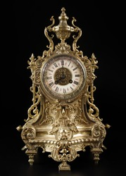 vintage bronze watch , antique clock photo, bronze fireplace clock, eight o'clock on the dial