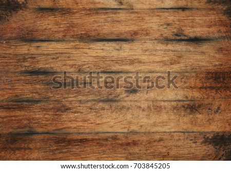 Vintage brown barrel wooden planks background texture with scratches and black stains over wood grain of old aged oak barrel bottom, close up