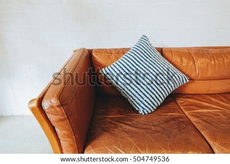 Vintage brown leather couch with pillow in living room #504749536