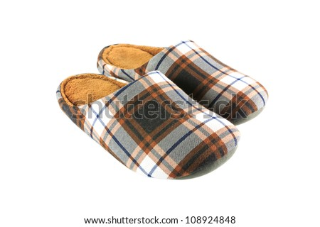 Vintage brown slippers isolated on white background