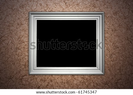 vintage brown wall with empty picture frame hanging on it - artistic shadows added