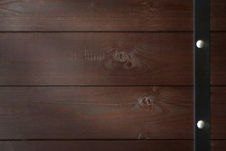 Vintage brown wood  barrel background. Old painted wood wall. Brown abstract background. Vintage wooden dark horizontal boards. Front view with copy space.