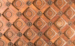 Vintage brown wood texture with metal decoration.