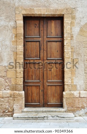 Vintage brown wooden door in Italy - stock photo