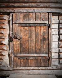 vintage brown wooden door in old barn