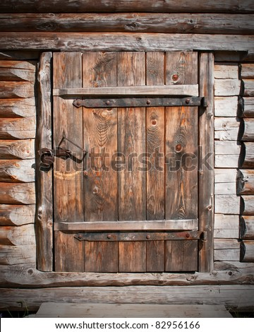 vintage brown wooden door in old barn - stock photo