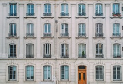 Vintage building facade wall. Rounded windows. Classic european architecture. Postcard concept. Travel inspiration. Luxury estate background. Film effect.