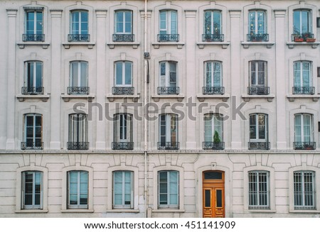 Vintage building facade wall. Rounded windows. Classic european architecture. Postcard concept. Travel inspiration. Luxury estate background. Film effect.  #451141909
