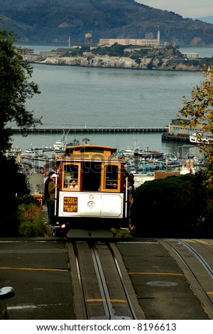 Vintage cable car in San Francisco with alcatraz in the background
