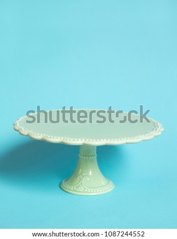 Vintage cake stand on blue background Foto stock ©