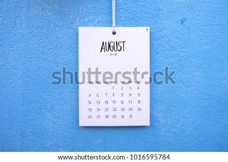 Vintage calendar 2018 handmade hang on the blue wall, August 2018