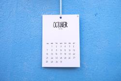 Vintage calendar 2018 handmade hang on the blue wall, October 2018