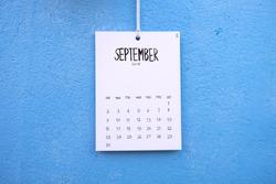 Vintage calendar 2018 handmade hang on the blue wall, September 2018