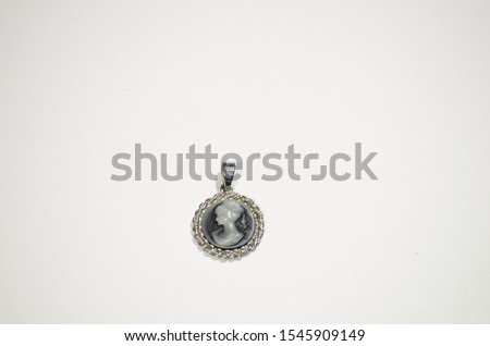 Vintage cameo pendant isolated on a white background. #1545909149