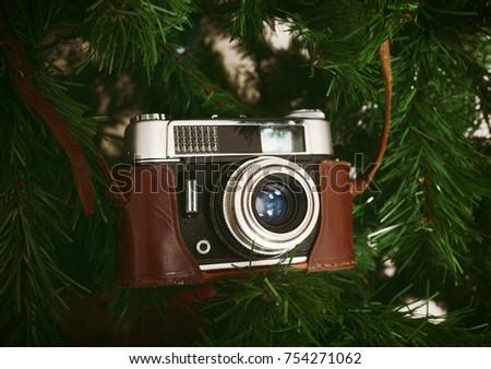 vintage camera hanging on...