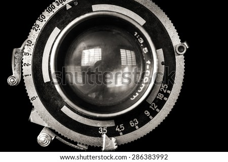 Vintage camera lens close-up isolated on black #286383992