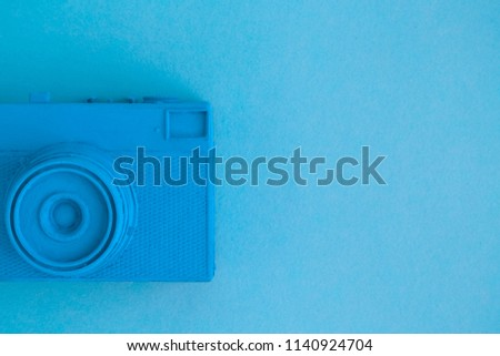 Vintage camera on background in pastel blue color minimal creative art concept. Space for copy. #1140924704