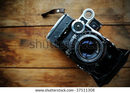 Vintage camera on wooden Vintage Camera Backgrounds