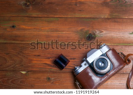 Vintage camera on wooden boards abstract background. Copy space for text. Top view. #1191919264