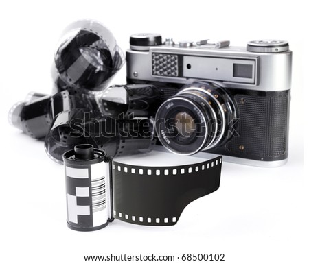 Vintage camera with a 35mm film on a  white background.