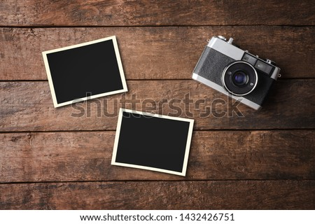 Vintage camera with empty photo frames. Top view #1432426751