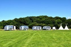 Vintage campsite with airstream trailers and teepees