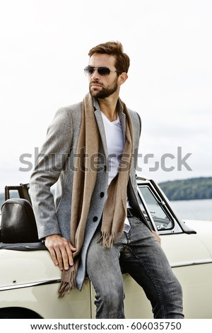 Vintage car and cool guy, looking away
