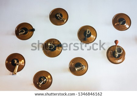 vintage car horns caught on the wall #1346846162