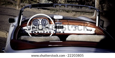 Vintage car - open Cabriolet white with red
