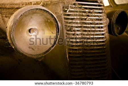 Vintage car wreck on a junkyard, cross-processed, some blur