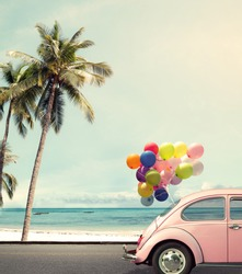 Vintage card of car with colorful balloon on beach blue sky concept of love in summer and wedding honeymoon