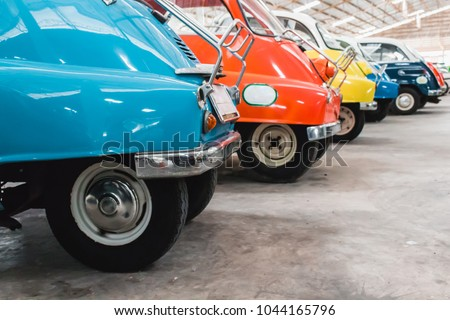 Vintage cars parking in a row. Row of colorful shine old classic car parking in the garage. Cool style from the past.